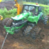 Pulling tractor out of swamp. John Deere 6620, Cat 312C.